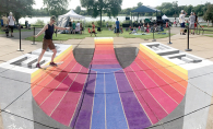 A person walks on a chalk drawing during the Eden Prairie Fourth of July celebration.