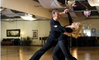 A couple ballroom dances at American Classic Ballroom.