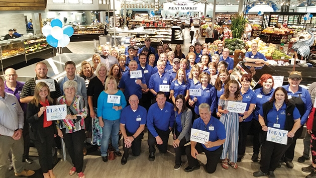 Employees pose for a photo at Mackenthun's Fine Foods Grand Opening