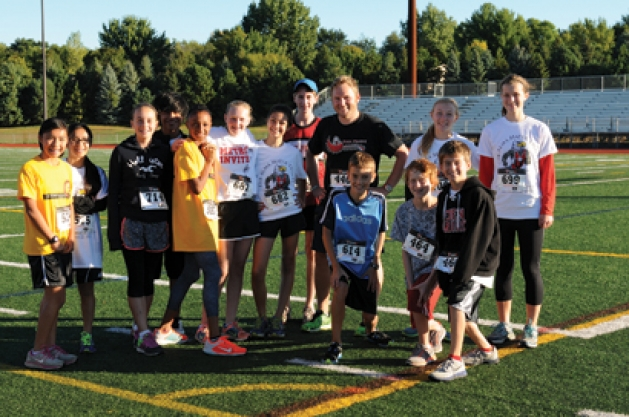 Andy Malone, EP grad and CMS teacher, with CMS runners