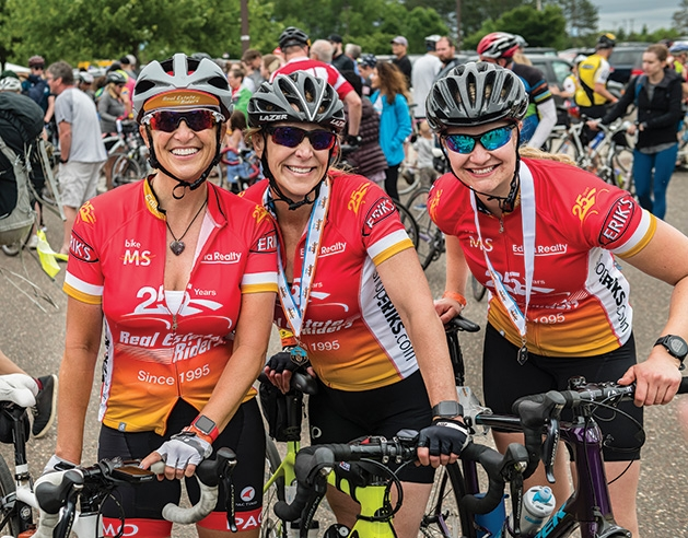 Ladies of Real Estate Riders celebrate at the finish line of the Bike MS: CH Robinson event.