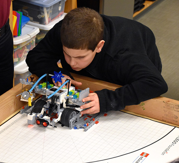 A St. Hubert's student lines up to complete a challenge with his Hubot.