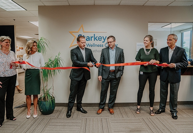 Starkey President Brandon Sawalich cuts the ribbon at the wellness center with Jeffrey Krautkramer, Starkey chief human resources officer.