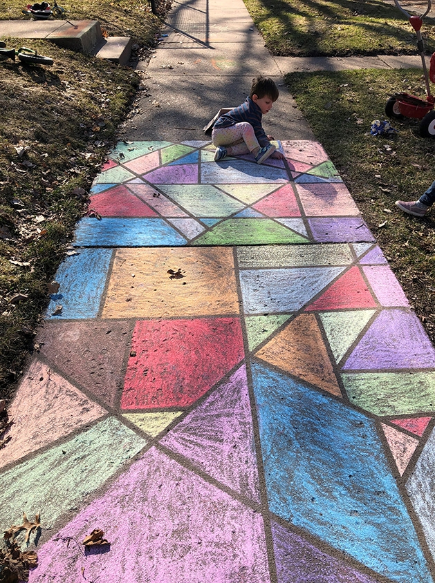 Jes Strom's children work on a chalk art project during the coronavirus pandemic.