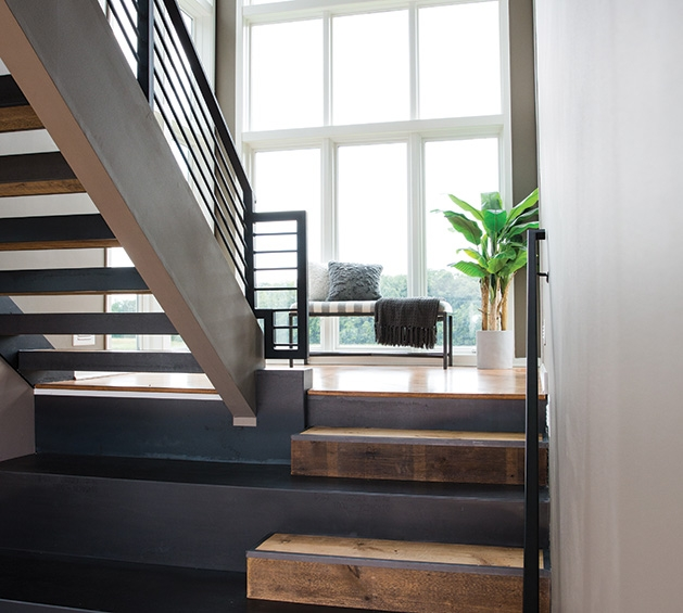 An iron staircase in a remodeled Chanhassen home