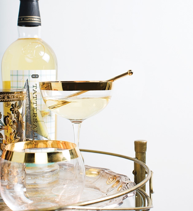 An aperitif sits on a bar cart with a bottle of liquor from Tattersall.