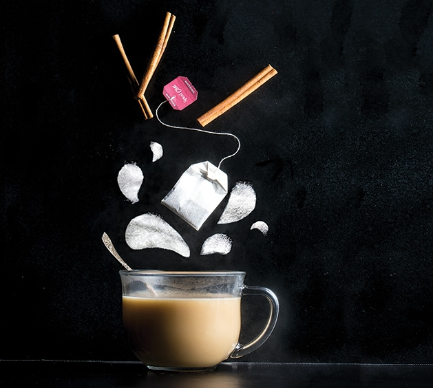 The ingredients of the 8th Day cocktail are poured into a glass coffee mug.