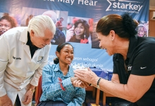 Bill and Tani Austin of Starkey Hearing meet with a patient.