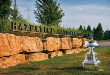 A trophy sits in front of the entrance to Hazeltine National Golf Club