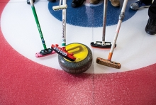 Curlers on the ice at the St. Croix Curling Center