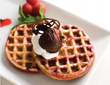Waffles with whipped cream and chocolate strawberries from Cafe Thyme.