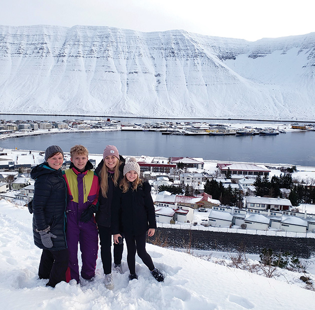 Katrin Sigurdardotti and her children (Kari, 16; Edda, 23; and Anja, 12) last Christmas with a view over Ísafjörður, a small town, where her mother is from in Iceland.