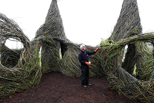 Patrick Dougherty stands inside of YouBetcha