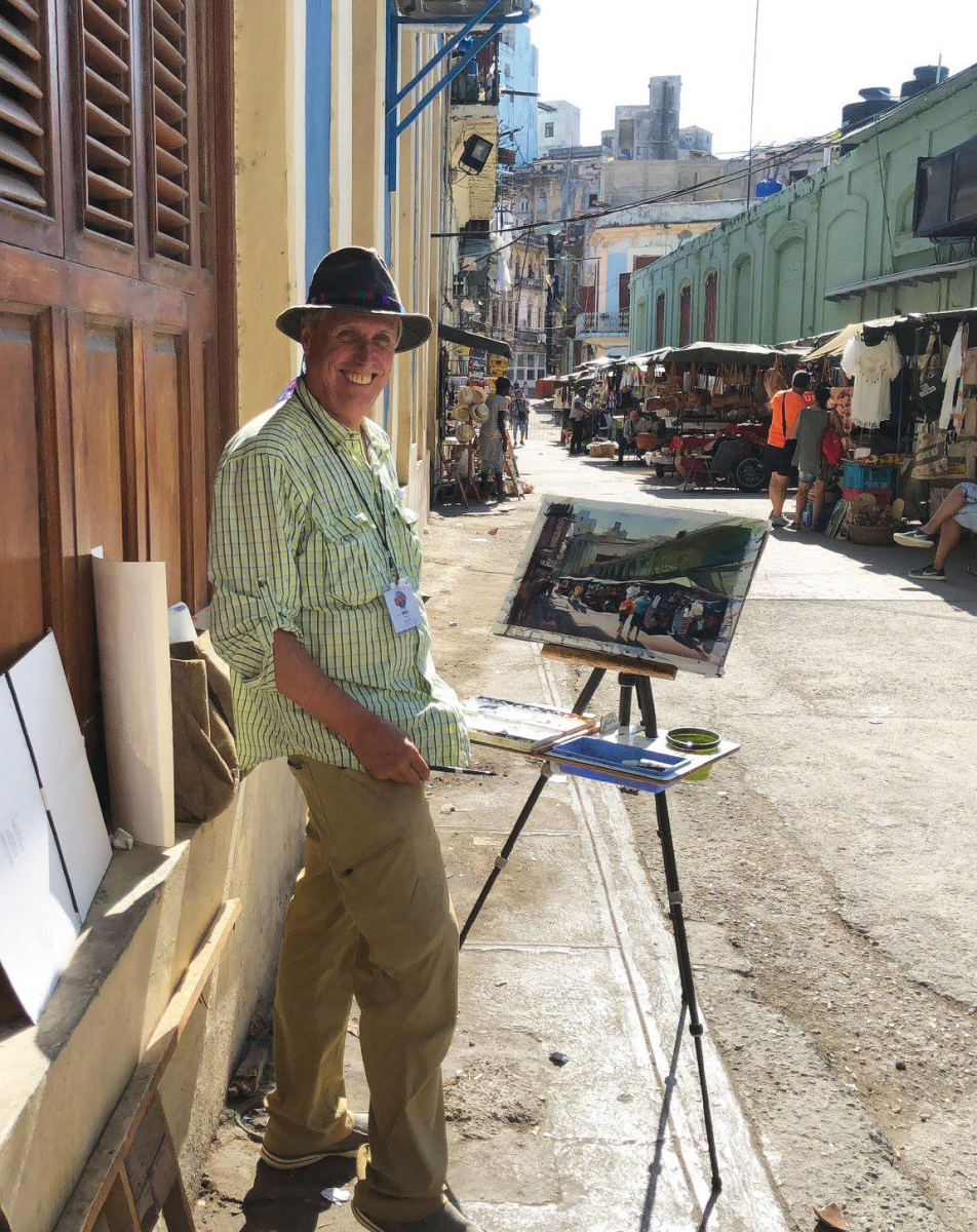 An artist paints in Cuba.
