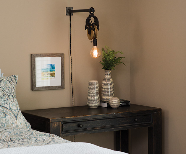 A pulley light in the master bedroom in a remodeled Chanhassen home.