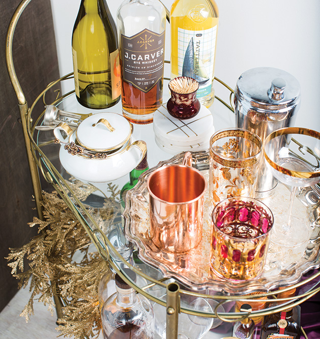Top it off: A well stocked bar cart hosts a variety of beverages and the necessary accoutrements.