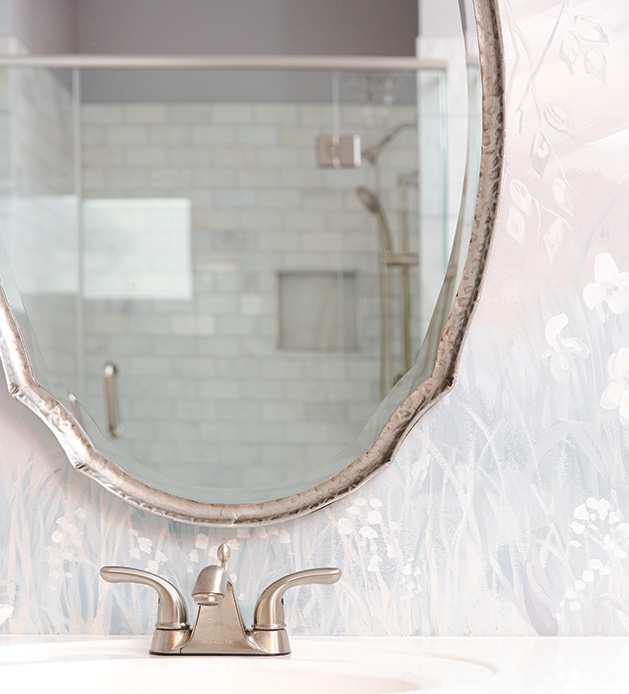 The mirror and sink of a remodeled bathroom in Victoria.